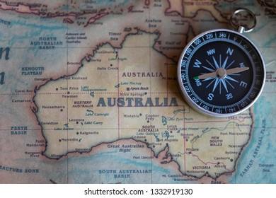 Compass on Australia part of world map. Travel to Australia concept.