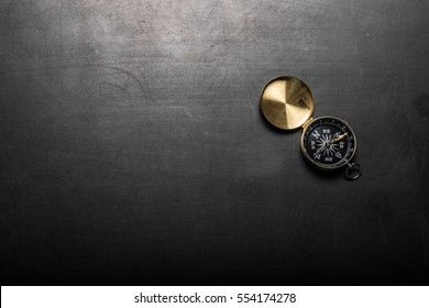 Compass on black board background