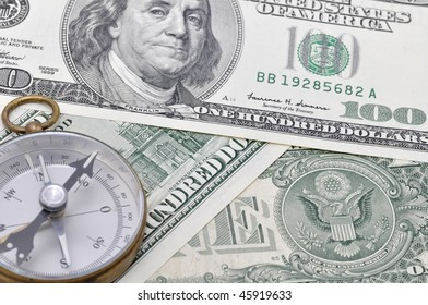 Compass on dollars.