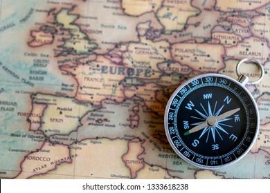 Compass on European part of world map. Eurotrip concept.
