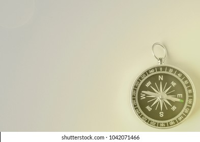 compass on gray background concept - direction motion top view