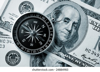 Compass on hundred dollar background