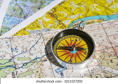 Compass on the map. Items necessary for orientation in travel.