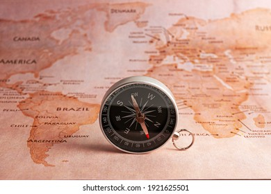 Compass on the map. The oldest navigation device to navigate the world. Travel, tourism, exploration and adventure while on vacation.