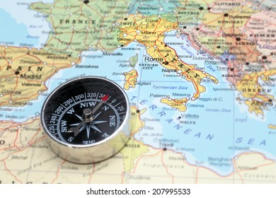 Compass on map pointing france planning stock photo 207995509 compass on a map pointing at italy and planning a travel destination gumiabroncs Image collections