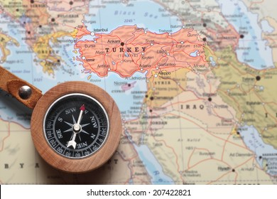 Compass on a map pointing at Turkey and planning a travel destination