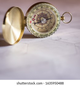 A compass on the marble and place the text