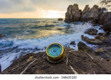 Compass on the rock.