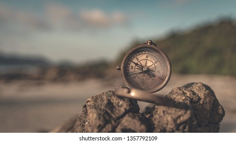 Compass On Stone With Sea View Background