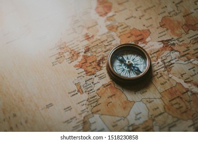 Compass on top of world map