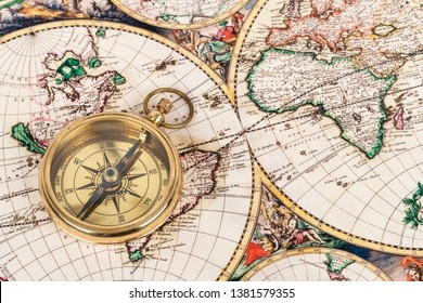 Compass on vintage ancient map, concept for direction transportation and travel