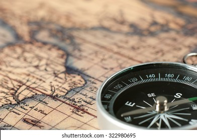 Compass on vintage map.