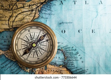 Compass on vintage map. Adventure, travel, stories background.