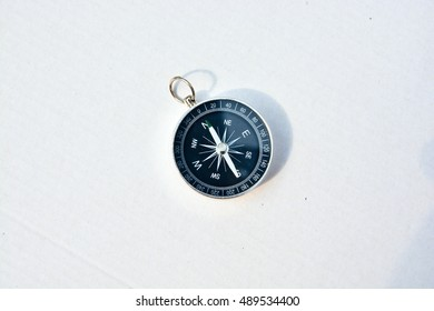 Compass on a white background. Magnetic navigation tool on a clean sheet of paper.