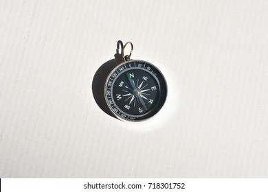 Compass on a white background. A navigation tool for travel and adventure.