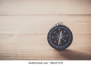 Compass on wood table