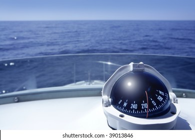 Compass on a yacht boat tower on a blue summer sea ocean day