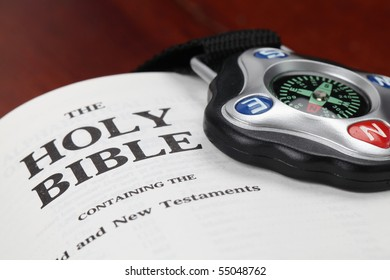 Compass and open Holy Bible