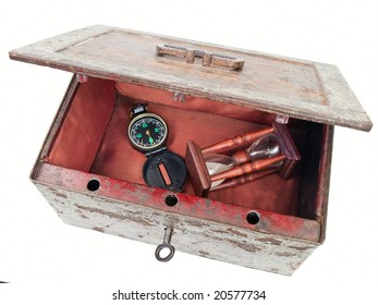 compass in open old chest over white background