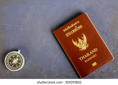 compass and passport thailand on Leather Cover background