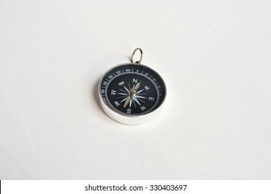 Compass. Photo of magnetic compass on white background.