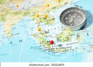 Indonesia map stock photos images photography shutterstock compass and pins on map with focus on jakarta capital indonesia gumiabroncs Choice Image