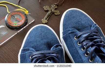 Compass, sneakers and map