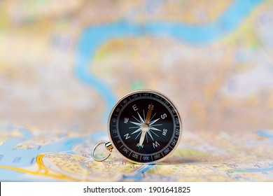 Compass standing vertically on the map of Saint Petersburg, concepts of travel, tourism and research, copyspace