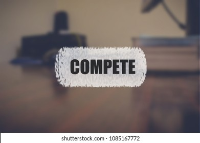 Compete word with blurring business background