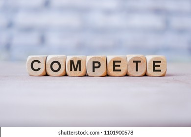 Compete word written on wood block