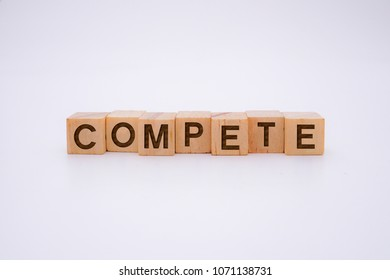 COMPETE Word Written In Wooden Cube