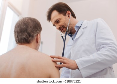 Competent experienced doctor using special tool