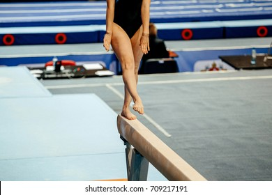 competition in artistic gymnastics balance beam woman gymnast