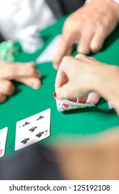 Competition between poker players. Risky entertainment of gambling