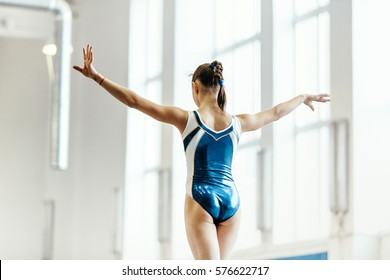 competition gymnastics balance beam exercises to back girl gymnasts