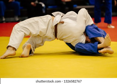 competition judo fight between two judokas on tatami