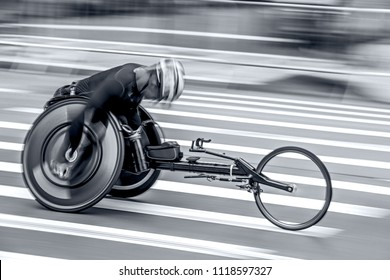 competition sports wheelchair racing in motion blur in monochrome blue tonality