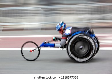 competition sports wheelchair racing in motion blur