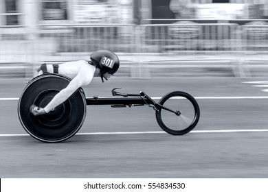 competition wheelchair in motion blur at the stadium