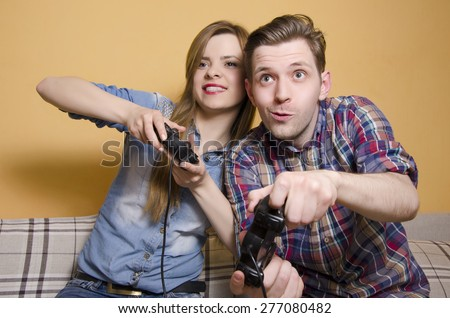 Competitive boyfriend and girlfriend playing video games, having fun. Selective focus on man