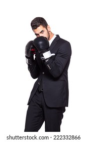 Competitive businessman in boxing gloves. Isolated on white