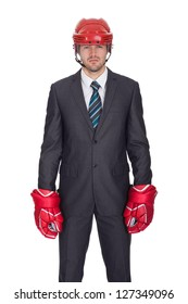 Competitive businessman wearing hockey equipment. Isolated on white