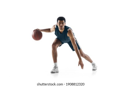Competitive. Young arabian muscular basketball player in action, motion isolated on white background. Concept of sport, movement, energy and dynamic, healthy lifestyle. Training, practicing.