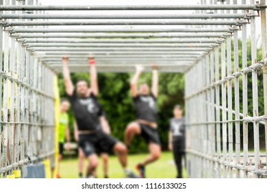 competitor runners in extreme obstacle course race