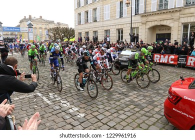 Compiegne, France - April 10, 2016: Paris-Roubaix bicycle race riders rolling out from the starting line.