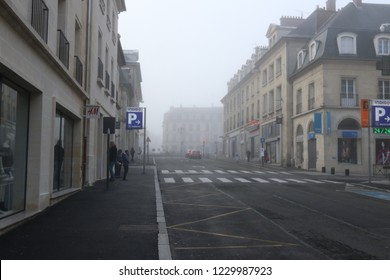 Compiegne, France - April 10, 2016: Ancient buildings in France shrouded in dramatic early morning fog