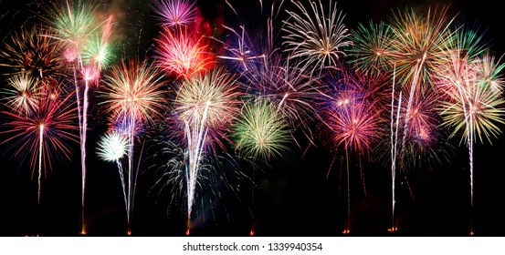 A compilation of fireworks on a long horizontal image.