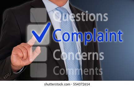 Complaint Questions Concerns Comments - Businessman with Touchscreen