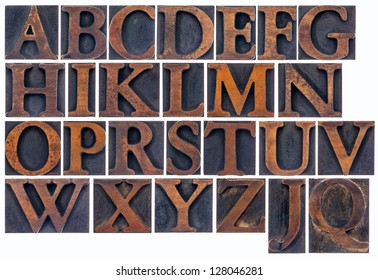 complete English alphabet  in vintage  wood type - a  collage of 26 isolated letterpress printing blocks stained by ink