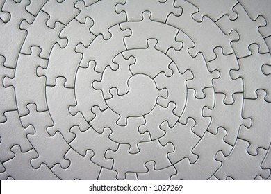 complete grey jigsaw wide angle - pieces fitting together in form of a spiral